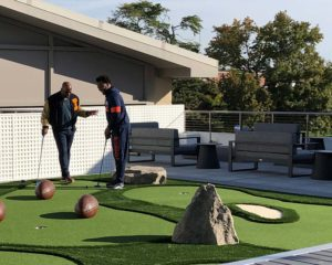 U of I football players enjoying the rooftop mini golf course at the Smith Football Center.