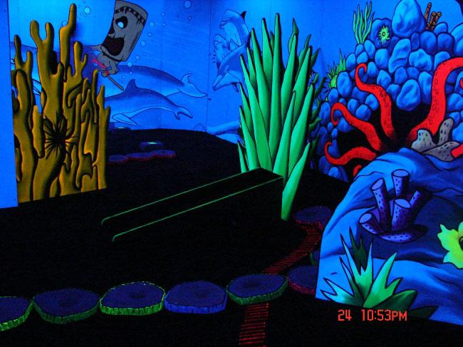 Blacklight mini golf at waikiki shopping center under water theme
