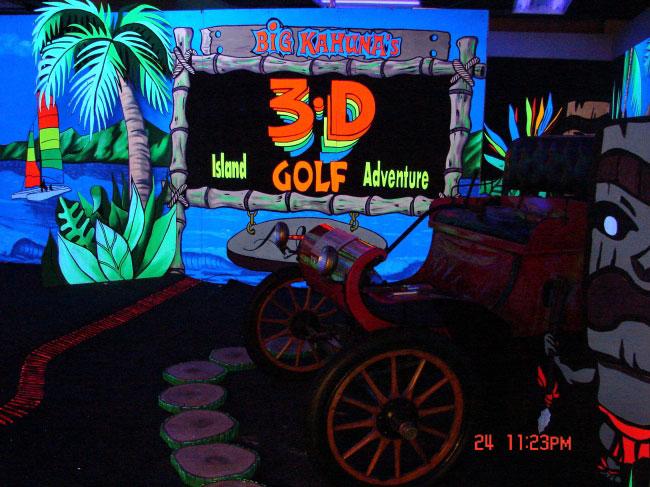 Blacklight mini golf at waikiki shopping big kahuna sign