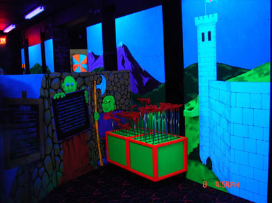 Blacklight mini golf at six flags castle theme element