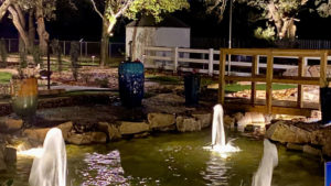 Water features at night on the Cen-Tex Mini Golf course designed and built by Adventure Golf & Sports