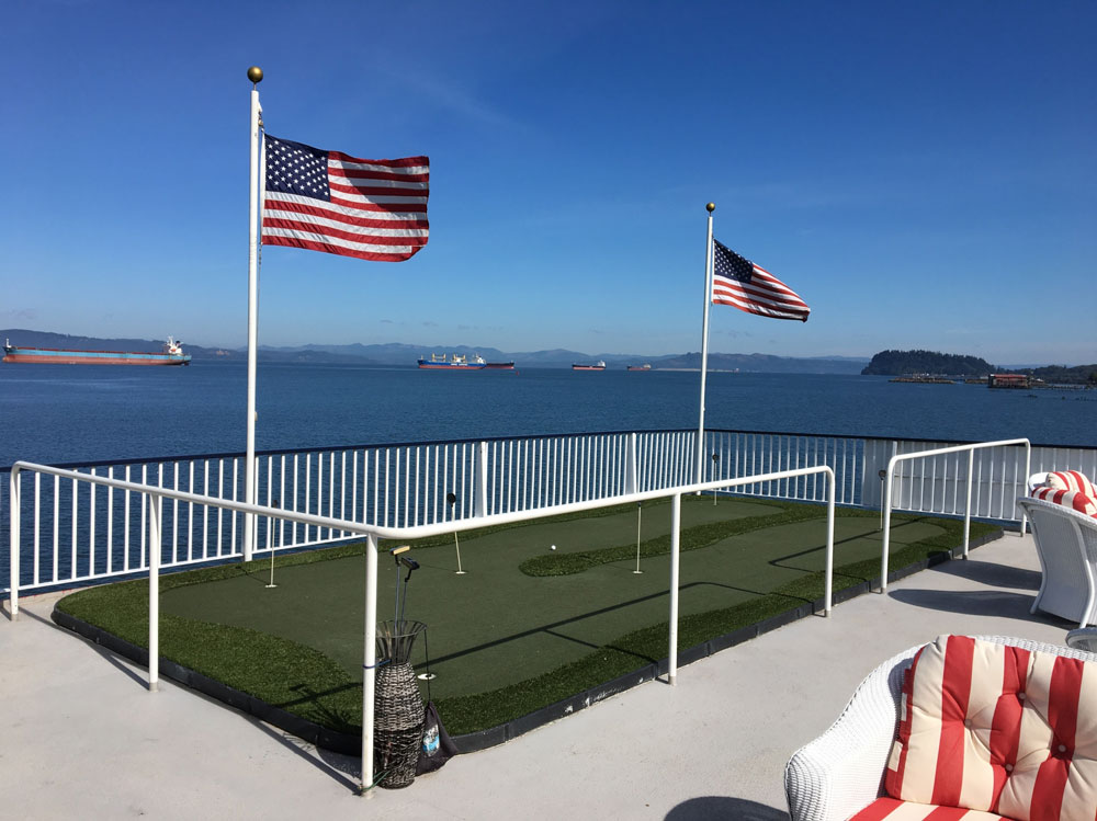 Cruise lines mini golf putting green with flag poles