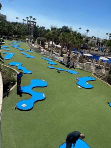 Marriott MiniLinks mini golf course with people playing