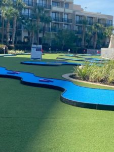 MiniLink hole with blue turf and Marriott Hotel in Orlando, Florida