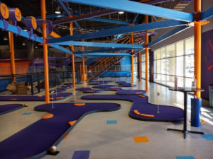 A miniature golf course with purple colored turf at Altitude Trampoline Park in Round Rock, TX.