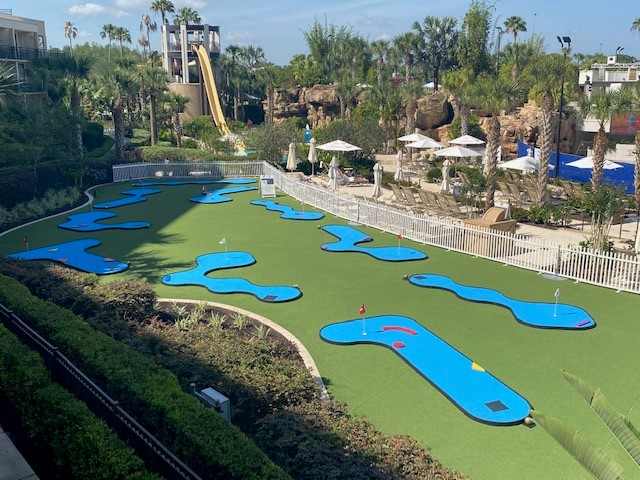 The blue-turf used for the portable 18-hole MiniLinks course stands out against the green lawn of the Orlando Marriott hotel.